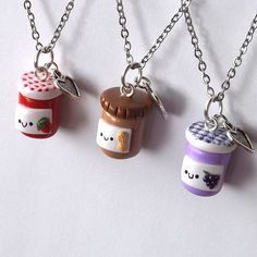 A set of three best friend necklaces of peanut butter and jelly jars to gift.  Three necklaces include:  A peanut butter jar, a strawberry