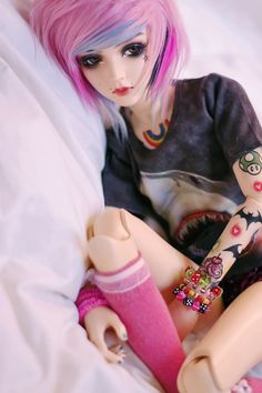 Ive pinned some others of this same doll. Her name is candy and someone on deviantART did her face up and stuff.  If you know who it is please put it in the comments because I forget