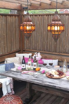 How to throw a delicious wine night dinner party! We love the idea to bring the indoors out, especially with pillows and other Moroccan inspired decor. What a gorgeous girls night outside!