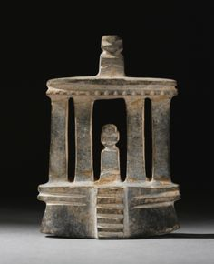 MEZCALA STONE TEMPLE,  LATE PRECLASSIC, CA. 300-100 B.C.  Estimate: 5,000 - 7,000 USD   LOT SOLD. 5,000 USD  (Hammer Price with Buyer's Premium)  the four column structure with a figure within and on top of the roof comb, with the edge of the roof serrated; in calcite.