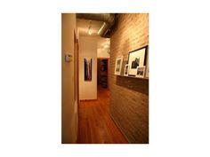 hallway brick & photos