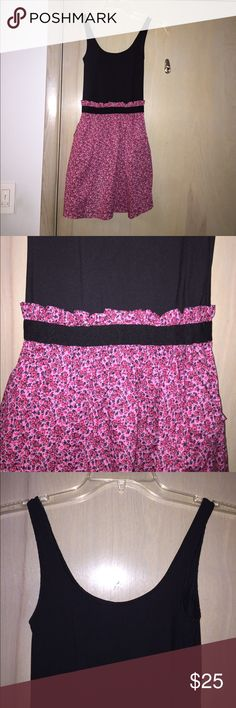 Victoria's Secret PINK dress Victoria's Secret PINK dress. Black solid top with pink skirt floral pattern bottom (one piece). Has pockets. Size S/P. Used. PINK Victoria's Secret Dresses Mini