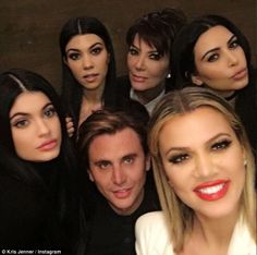 Keeping it together: The momager appeared a little glassy eyed in a family selfie she post...