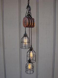 antique pulley pendant light for living room...omg, love this! Would love for my home to be a blend of industrial & rustic.