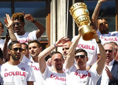 Robert Lewandowski and Franck Ribery  celebrate with the German Cup trophy during the victory parade