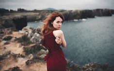 Outdoor, looking back, red head, woman