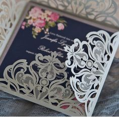 silver laser cut wrap with pink flowers on navy blue background inner invitation Pocket Wedding Invitations, Laser Cut Wedding Invitations, Blue And Blush Wedding, Floral Wedding, Flower Graphic Design, Floral Invitation, Wedding Paper, Navy Blue, Dusty Blue
