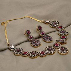 Silver finished white and ruby stone embellished necklace set available only at Pernia's Pop Up Shop. Antique Jewellery Designs, Fancy Jewellery, Stylish Jewelry, Fashion Jewelry, Indian Jewelry Sets, Silver Jewellery Indian, Silver Jewelry, Silver Ring, Terracota Jewellery