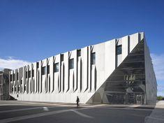 Aix en Provence Conservatory of Music by Kengo Kuma, Aix en Provence, France. Folded aluminium panels create vertical and horizontal pleats across the walls