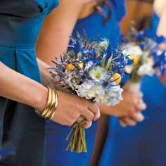 romantic, traditional, winter Michigan real wedding    Bridesmaids donned cobalt blue dresses and carried nosegays of hydrangeas and thistles. Abby Rose Photo.