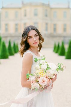 "From the editorial ""Let Cobblestone Paths Guide Your Way to This Enchanting Chateau Just Outside of Paris."" @floraisonparis intertwined garden roses, peonies, and lisianthus with fragrant eucalyptus to create this breathtaking bouquet! Amazed? Us too. 💐 LBB Photography: @oliverflyphotography #stylemepretty #weddingbouquet #weddingflowers #boutquet #bridebouquet #brideinspiration"