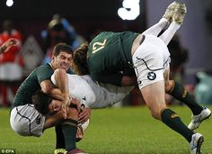 Brad Barritt, the England centre, is halted by two South African players South African Rugby, Rugby Men, Beefy Men, World Of Sports, Cycling Shorts, First Photo, Photo Art, Centre, Coaching