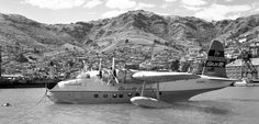 Ansett Short Sandringham VH-BRC at Lyttleton in November 1957. This was after the end of Ansett's Chathams' service, the aircraft being in New Zealand fliming for a Cinerama movie. Note the large camera turret installed in the bow hatch. Photo : P Sheehan Collection