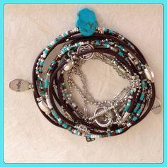 Boho Chic Leather Hamsa Wrap Bracelet with Silver by DesignsbyNoa