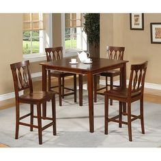 Add a great place for eating and visiting with this solid-wood, five-piece, pub dining table set, which includes a table and four matching chairs. The sets height makes it look like it came straight out of a pub, which is sure to impress your friends.
