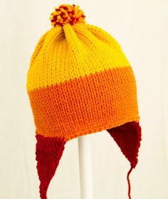 Yellow... orange... red... knitted hat...