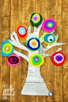Kandinsky Inspired Tree made with Felt Scraps. This beautiful Kandinsky Inspired Tree made with Felt Scraps is perfect for working on scissor skills with children and a stunning piece of process art. Combine fine motor skills and art with this fab kids craft project.