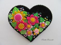 Felt Flower Heart Pin / Brooch. $24.00, via Etsy. (reminds me of ME art)  Paulette Racanelli