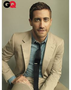 Jake Gyllenhaal. Khaki suit with chambray shirt & dark knit tie. Good combo.