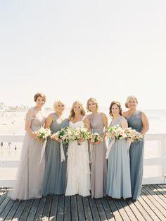 Pale colored dresses: http://www.stylemepretty.com/2015/05/15/dusty-blue-lavender-spring-garden-wedding/ | Photography: Joey Kennedy - http://carmensantorellistudio.com/