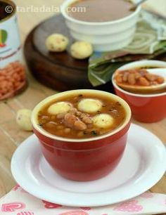 Two treats in one package, that's what the Baked Beans Soup in Cheese Balls is! Scrumptious, chilli-speckled cheese balls are a delight to bite into, while the tangy, creamy baked beans soup is a pleasure to slurp up! When you taste this soup, the first thought that comes to mind is that it has a perfectly balanced yet exciting combination of flavours and textures, with baked beans bound together with vegetable stock, and flavoured with herbs, onions and tomato ketchup too.