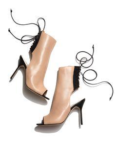 Manolo Blahnik peep-toe booties with leather lacing.