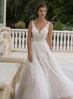 Tasteful A-line Eve of Milady wedding dresses with lace details; click to see more gorgeous gowns from this collection.
