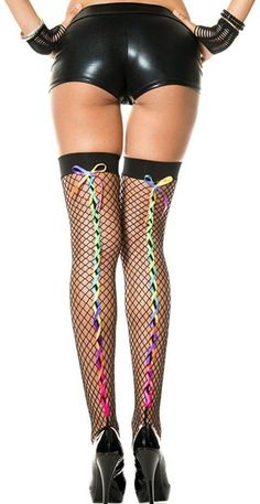 Rainbow Lace Up Fishnet Stocking Thigh High from Rave Wonderland. Shop more products from Rave Wonderland on Wanelo.