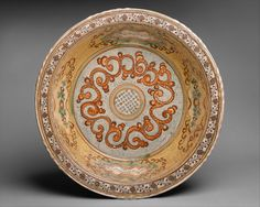 basin with polychrome scroll motif on strippled ground   Tin and lead glazed earthenware