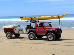 Suzuki Samurai at the ocean! Awesome trailer and kayak. Costa Rica Trippinoffroad.com