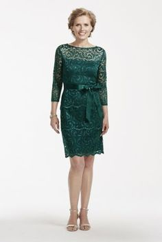 Ultra-feminine and chic, this all over floral lace tiered dress is perfect for any special occasion!  3/4 sleeve bodice features a sheer, illusion lace scoop neckline and a keyhole back for added allure.  Tired floral lace adds drama and texture to this simple and classic silhouette.  Waist accented with a dainty satin self-tie sash.  Knee-length skirt features scalloped lace hemline.  Designed by Marina.  Fully lined. Imported polyester. Back zipper.  Hand wash in cold water. Lay flat to…