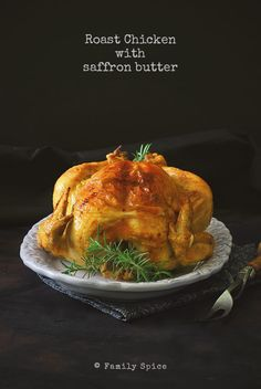 A roasted chicken gets it's golden color and fragrant flavor from baking in a saffron butter glaze. -- FamilySpice.com #roastchicken #chicken #saffron #saffronchicken