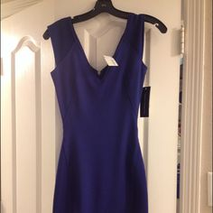 French Connection Rita Mix Jersey V Neck Dress Ribbed Cap sleeves with a V neck in the front and back.  Ribbed panels at sides. Brand new with tags. Tag says blue but leans more towards deep purple blue color. This was one of my inspirational purchases to loose weight. French Connection Dresses