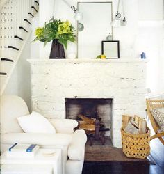 White fireplace. Brick hearth.  Love the mirrors and arrangement too!