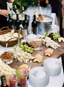 Cheese station at wedding reception | Photos by Cooper Carras, Flowers by studio choo