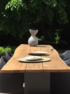 outdoor table by tiiset, incline vase and guscio trays by imperfettolab, espresso cup by wonki ware, lollypop chair. all at tiiset rooms munich