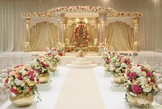 Shreeya Palace - Indian Wedding Decor, cream and gold mandap with florals on top Indian Wedding Stage, Outdoor Indian Wedding, Wedding Stage Design, India Wedding, Tamil Wedding, Wedding Reception Entrance, Wedding Hall Decorations, Wedding Mandap, Wedding Halls