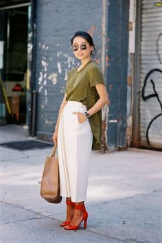 Shop this look on Lookastic:  https://lookastic.com/women/looks/tunic-culottes-heeled-sandals-tote-bag-sunglasses-watch/10980  — Brown Leopard Sunglasses  — Olive Tunic  — Black Leather Watch  — White Culottes  — Tan Leather Tote Bag  — Red Leather Heeled Sandals