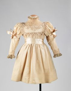 This fancy little girl's party dress was purchased at the prestigious Parisian department store Le Bon Marché circa 1895.