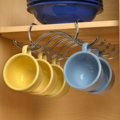 Free up precious cabinet space with the Under the Shelf Mug Holder. Stores up to ten of your favorite mugs or tea cups in style.