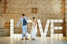 """There's no better time than your wedding to share exactly how you are feeling. These """"love"""" signs will leave no doubt in your guests' minds just how smitten you two are with each other. Use these signs throughout your reception venue to add a touch of romance to match your own theme."""