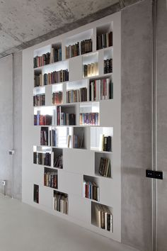 Full-wall shelves, with closed doors or drawers scattered here and there to break it up.  Books or DVDs.
