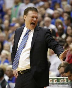 Kansas head coach Bill Self tries to cool down the bench after a foul was called against Joel Embiid during the second half on Monday, Feb. 24, 2014 at Allen Fieldhouse. #KU
