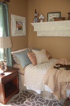 Love the fabric patterns and distressed wood frame and shelf