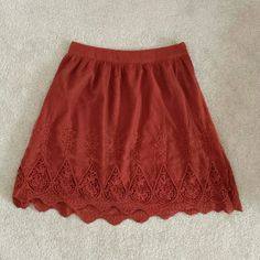 Forever 21 burnt orange skirt size small Soft gauze material on top with embroidered pattern on the bottom. Lining inside. 19 inches in length. Forever 21 Skirts