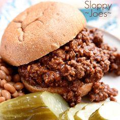 Homemade Sloppy Joes Recipe Lunch and Snacks, Main Dishes with garlic, ground beef, tomato sauce, ketchup, brown sugar, worcestershire sauce, prepared mustard, garlic powder, onion powder, ground black pepper, hamburger buns, pickles