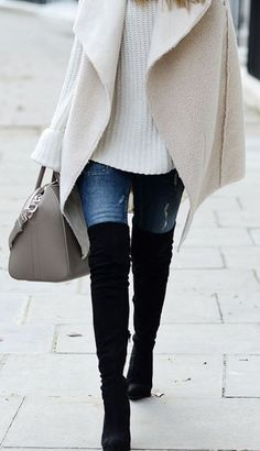 over size white sweater, skinny jeans, over size cream wool vest, black otk boots http://www.office.co.uk/overthekneeboots/womens