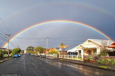 A double rainbow and supernumerary rainbow span the Melbourne suburb of West Brunswick soon after the passage of a storm front - the Decembe...
