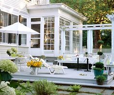 Back Patio - A seemingly small back patio gives plenty of room to relax after a long day. Pots of small bushes, herbs, and Black-Eyed-Susan flowers brighten and connect this outdoor space with the surrounding flourishing greenary. The white/gray pallete of the patio gives nature the fame and the spotlight.