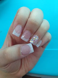 A simple fun way to spice up a traditional French full set.!! French in white glittery acrylic, with that popping ring finger full of glitter!!